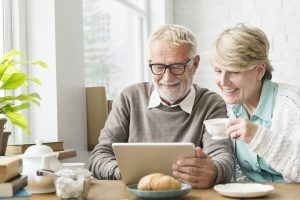 older retired couple looking at their financials
